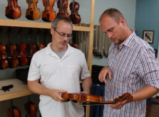 Stephen Nowels and Chris Clark inspect an instrument.