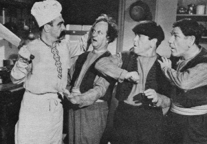 """A much thinner, mustachioed Curly as a chef in """"Malice in the Palace,"""" from 1949."""